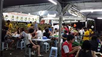 Crowds pack the tents for a durian buffet.
